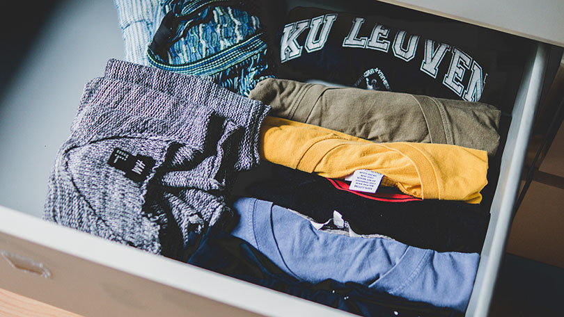 Drawer of folded shirts