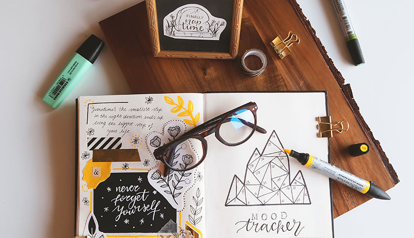 Creative bullet journal with hand lettering and illustrations.
