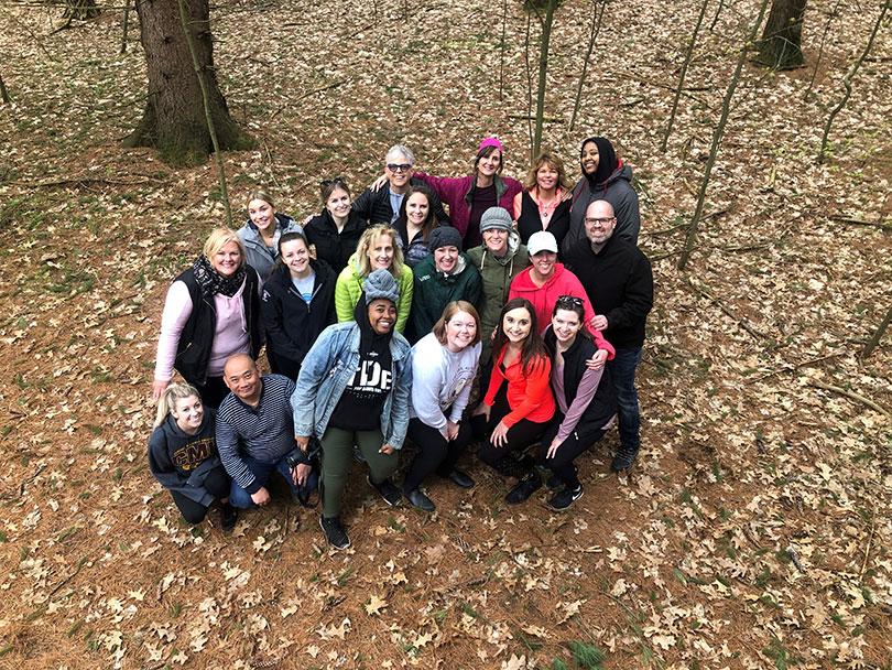 Brogan group photo at Camp Tamarack during team building experience