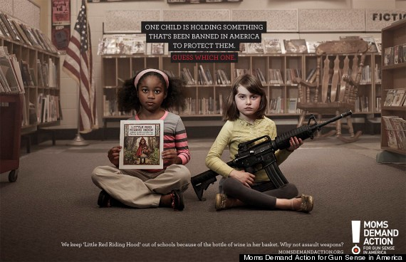 Child holding book and another child holding gun.