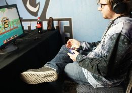 Young man playing video game at a desk