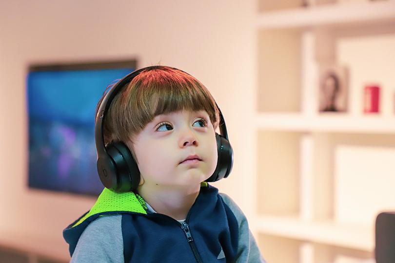 Little boy wearing headphones
