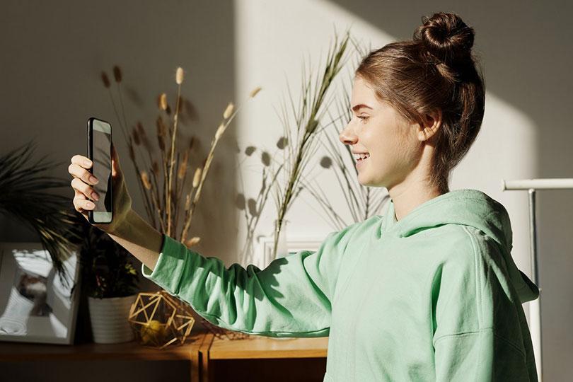 Teenage girl holding a smart phone.
