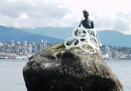Plastic six-pack rings caught on mermaid statue