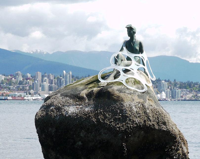 Plastic six-pack rings caught on mermaid statue