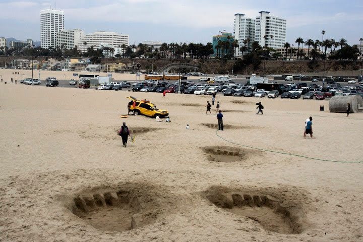Giant footprints in sand