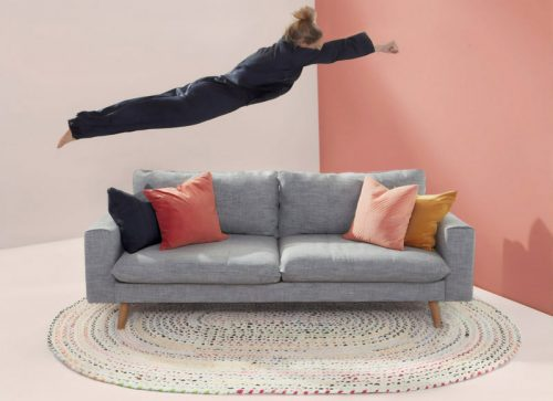 Woman diving onto a couch